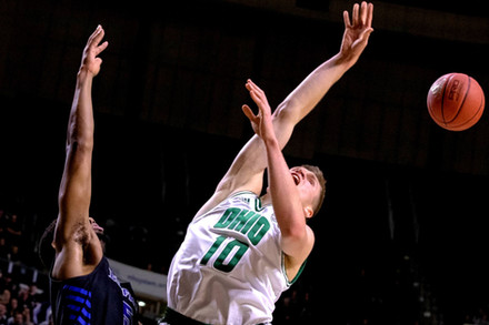 Buffalo guard CJ Massinburg (#5) blocks Ohio guard Connor Murrell (#10) from making a shot in a match held at the Convocation Center in Athens, Ohio, on March 5, 2019.
