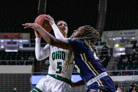 Ohio guard Caitlyn Kroll (#5) dodges Kent State's forward Monique Smith (#25) and aims for a shot in a match at the Convocation Center on Saturday, Feb. 8, 2020.