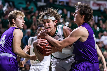 Ohio's foward Ben Vander Plas (No. 5) charges through Capital's wing Trey Meister (No. 4) and forward Will Hannah (No. 11) in the first game of the season at the Convocation Center on Saturday, Nov. 2, 2019.