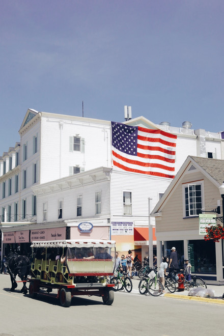 A horse-drawn buggy passes through town on Mackinac Island in Michigan's straits on July 3, 2019.
