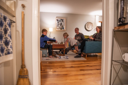 The Wedel family engages in a game of chess shortly after dinner on the night of Saturday, Nov. 14, 2019.