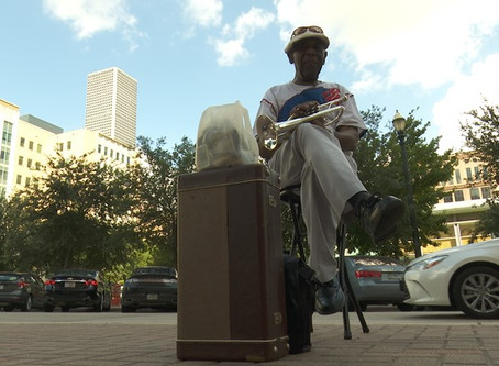 Video: Musician hopes songs bring peace outside Harris County courthouse