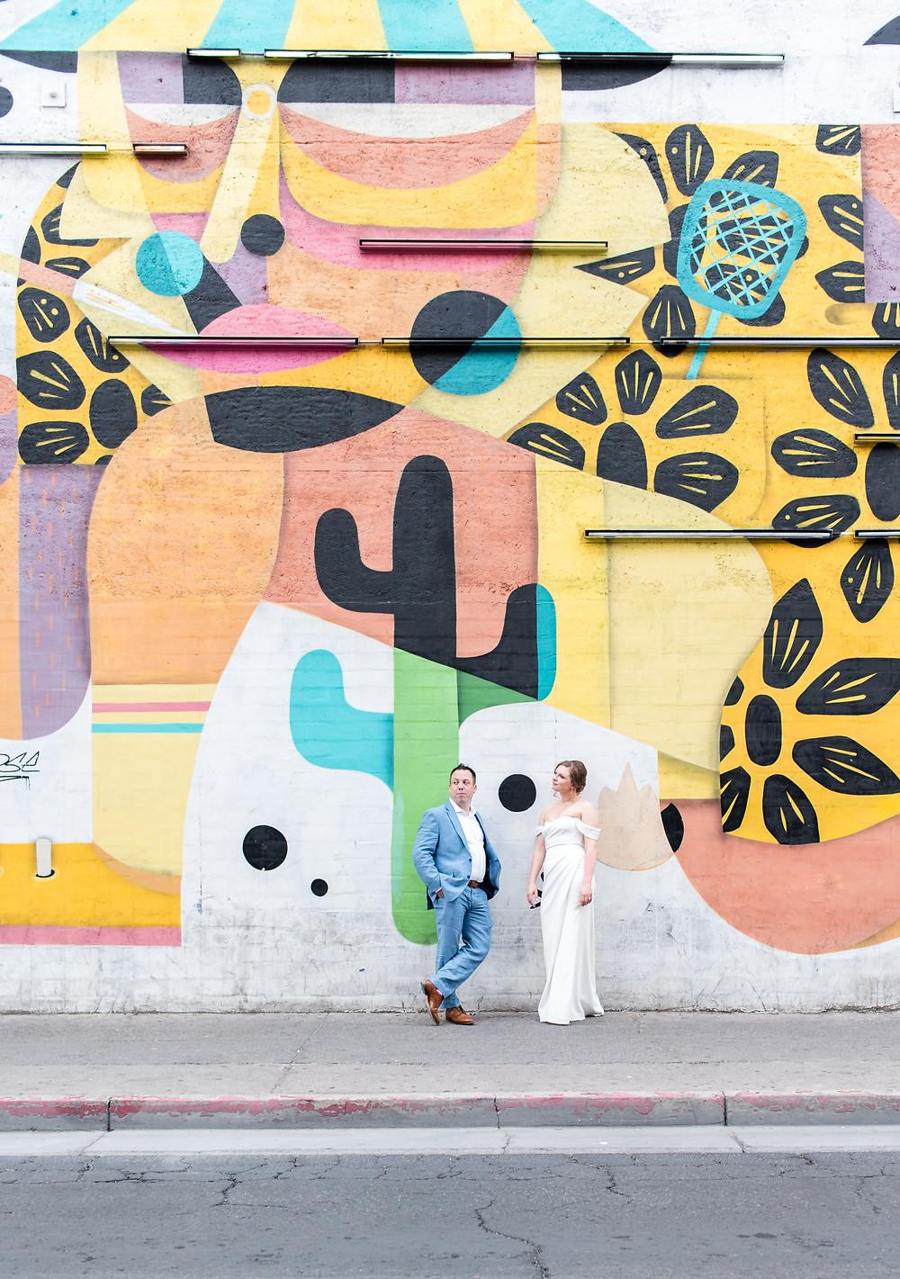 las vegas, vegas wedding, wedding, las vegas photographer, destination wedding, elopement, downtown art mural, art mural, neon, portraits, bride and groom, photography, just married, vegas weddings