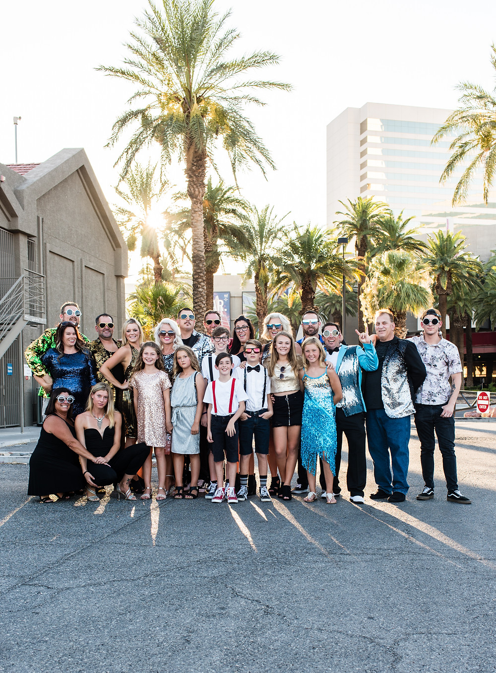 wedding party and guests group photo outside a las vegas strip wedding chapel for a vow renewal