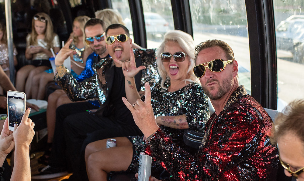 wedding party in party bus on the way to a Las Vegas Wedding Chapel to celebrate 20 years of marriage