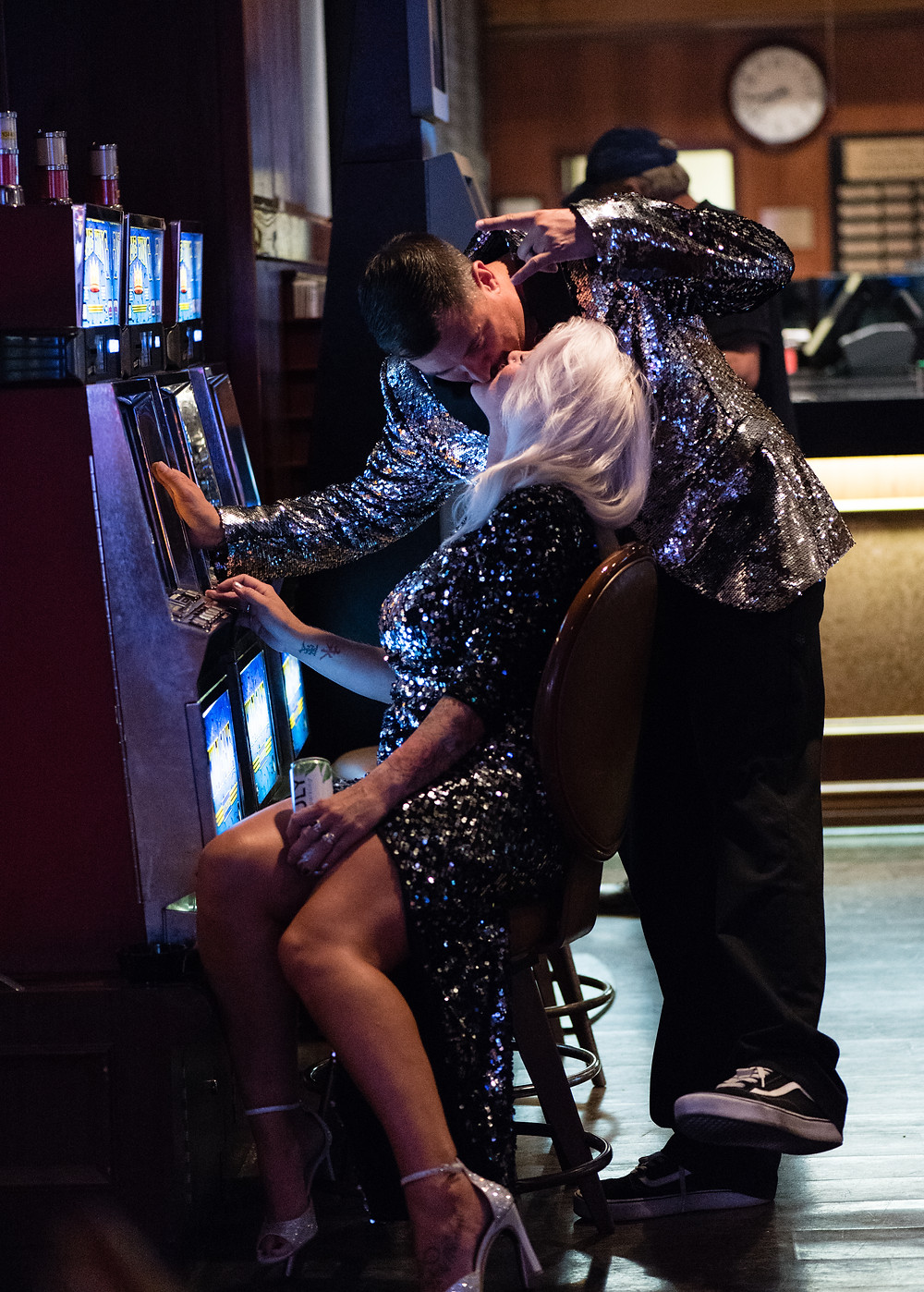 bride and groom kissing in front of slot machines in las vegas, nevada