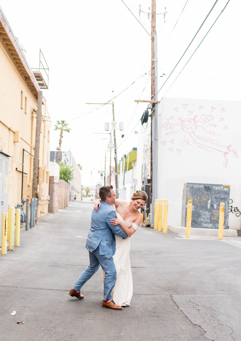 las vegas, vegas wedding, wedding, las vegas photographer, destination wedding, elopement, downtown art mural, art mural, neon, portraits, bride and groom, photography, just married, vegas weddings