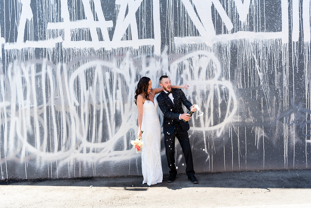 desert wedding, chapel wedding, las vegas, las vegas wedding photographer, downtown las vegas, intimate wedding, vegas elopement, wedding inspiration, vegas elopement photographer, art murals, pandemic elopement, pandemic, covid-19 wedding, las vegas strip, elopement wedding, destination wedding photographer, fun vegas elopement, champagne pop, wedding toast, fun elopement, vegas fun elopement, epic elopement, las vegas sign, iconic wedding, vintage vegas, sure thing chapel, fremont st