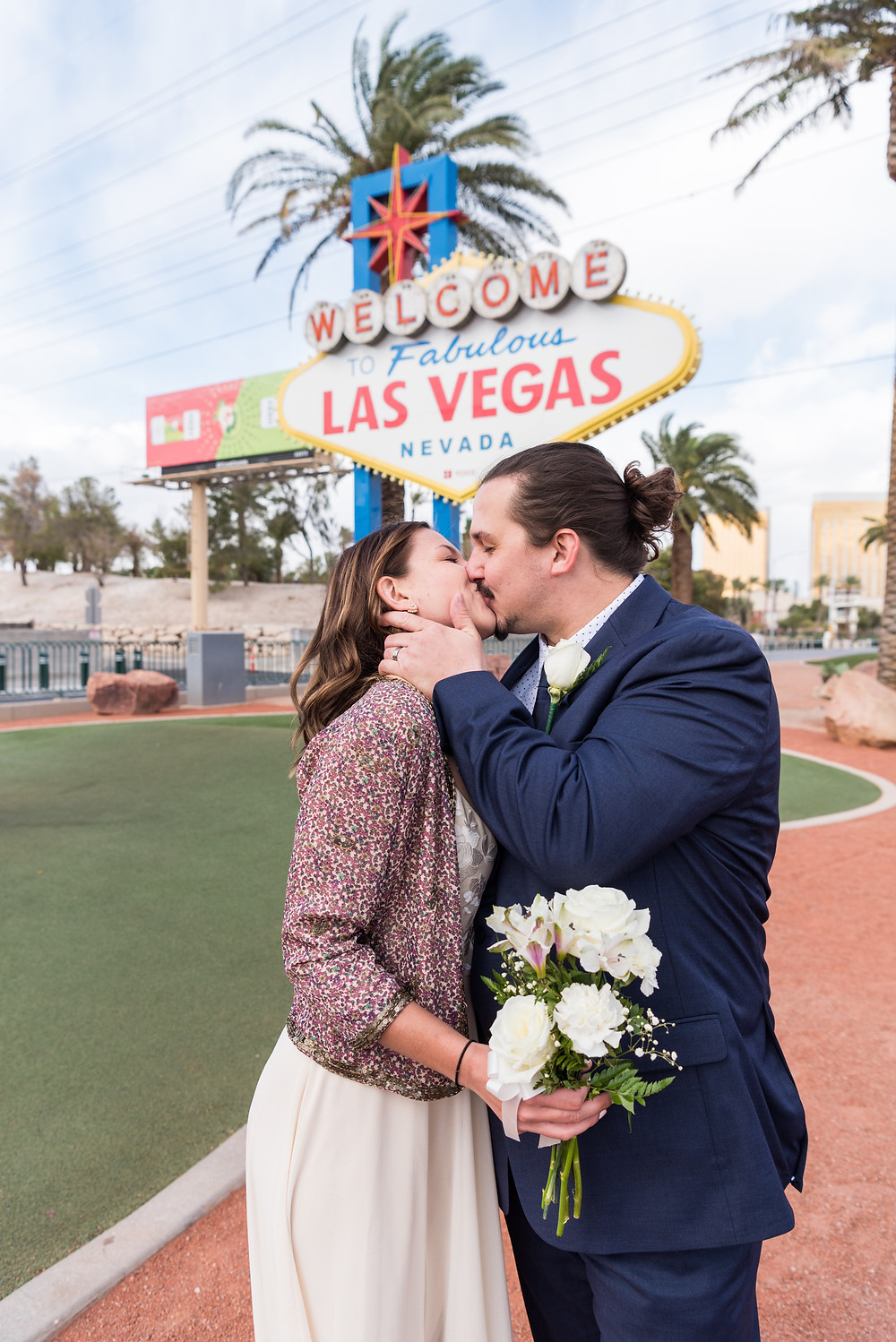 desert wedding, chapel wedding, las vegas, las vegas wedding photographer, downtown las vegas, intimate wedding, vegas elopement, wedding inspiration, vegas elopement photographer, art murals, pandemic elopement, pandemic, covid-19 wedding, las vegas strip, elopement wedding, destination wedding photographer, fun vegas elopement, champagne pop, wedding toast, fun elopement, vegas fun elopement, epic elopement, las vegas sign, iconic wedding, vintage vegas