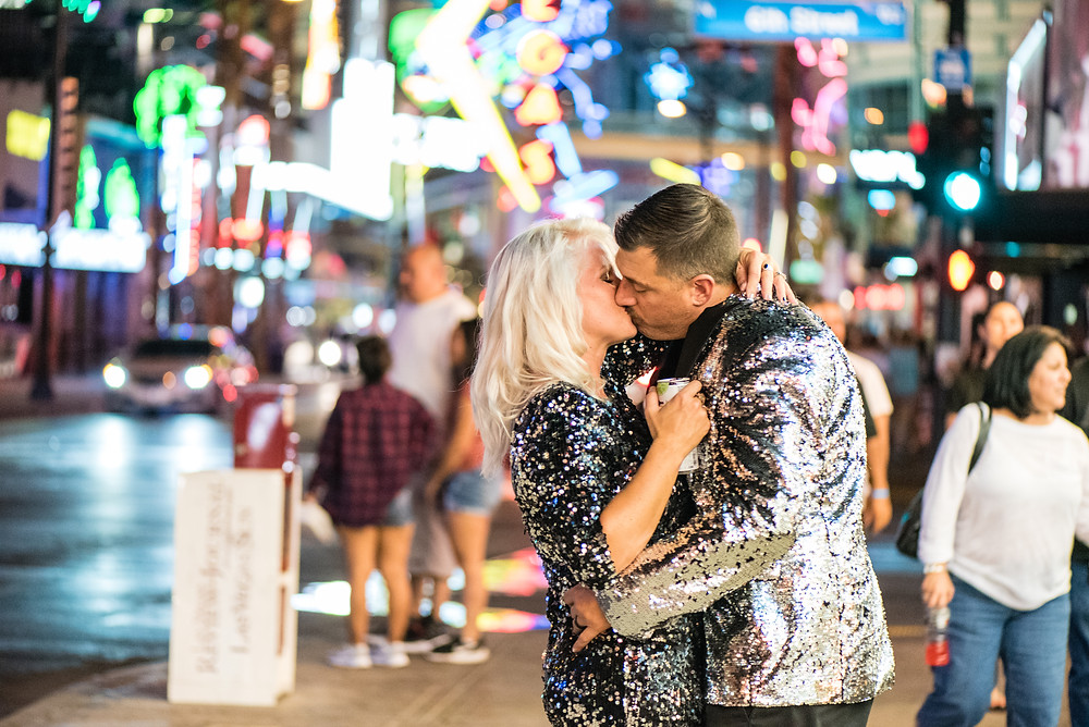 las vegas bride and groom embrace downtown outside the neon lights of fremont street
