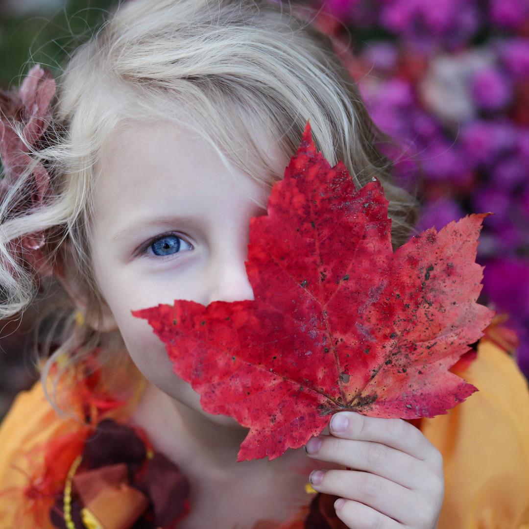 Girl with Autumn Leaf