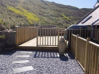 The terrace and main deck at the rear of the cottage