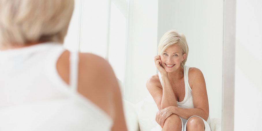 o-WOMAN-LOOKING-IN-MIRROR-facebook.jpg