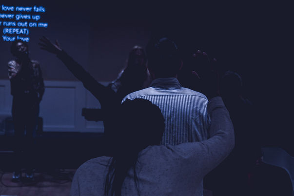 young adults and students worshipping in church