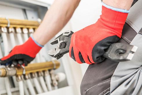 technician-repairs-heating-JFGPBHA.jpg