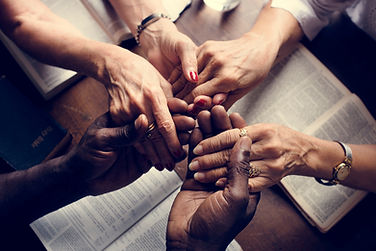 People holding hands and Praying Together