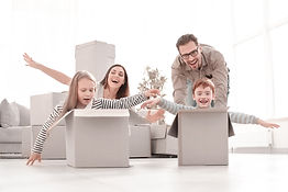 fun family using the boxes to play in th