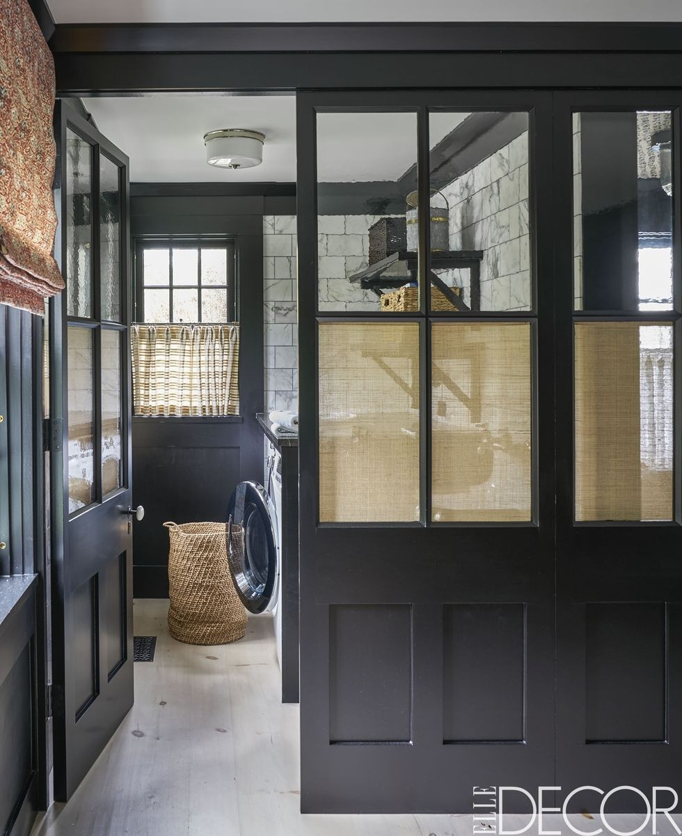 Black laundry room, white marble, traditional home, Elle Decor