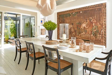 Traditional interior design, concrete dining table, tapestry