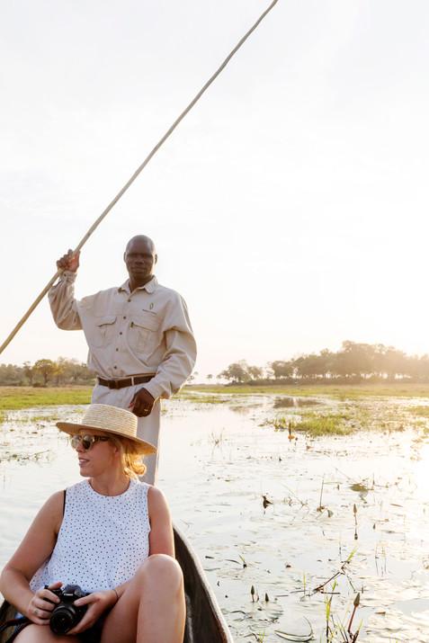 Shannon exploring the Okavango Delta, Botswana, by mokoro boat