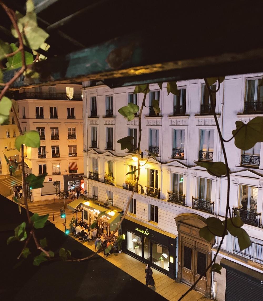 Night scene on Paris street from window