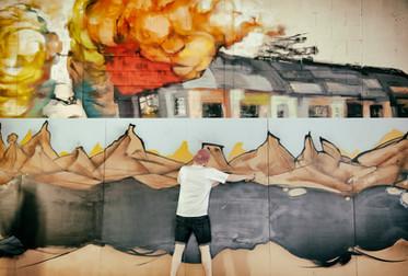 unknown artist at work preparing for an exhibtion in leeds