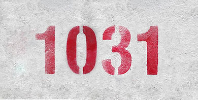 Red Number 1031 on the white wall. Spray