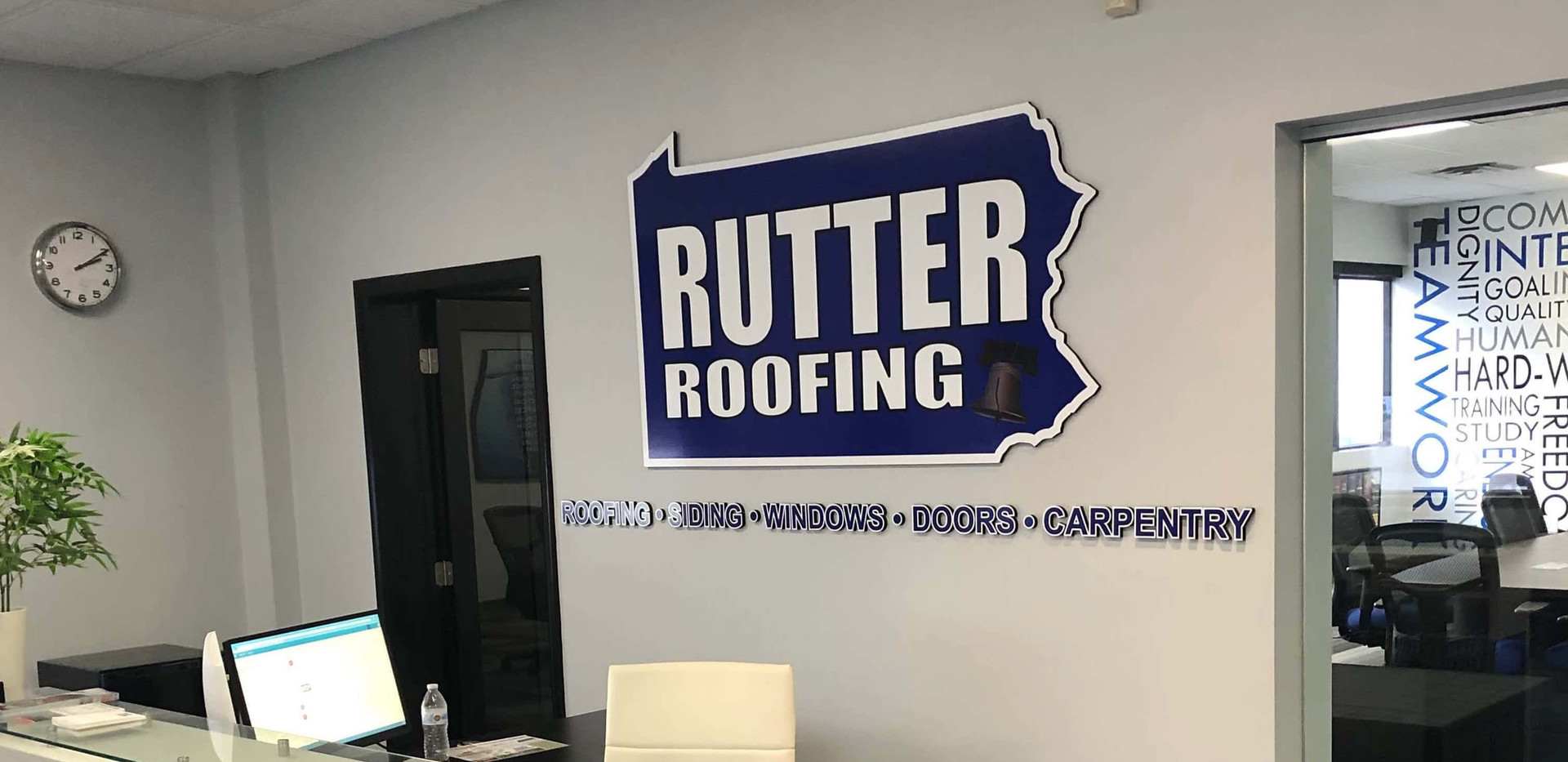 Closeup Rutter Roofing w_ Sign at Recept