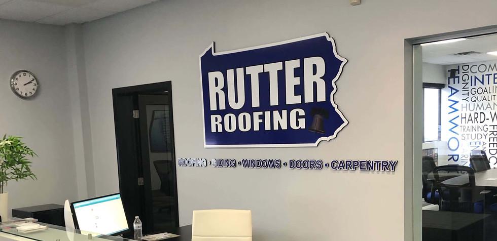 Closeup Rutter Roofing w_ Sign at Recept