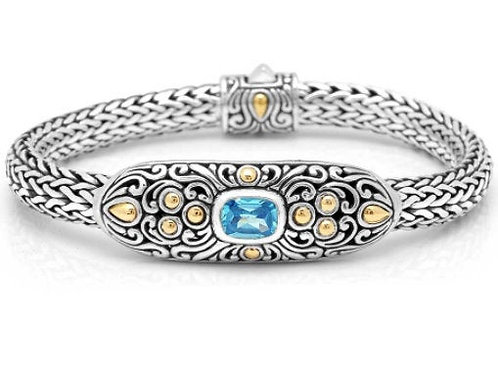 The Artistry - Handmade Sterling Silver Bracelet with Blue Topaz and Yellow Gold