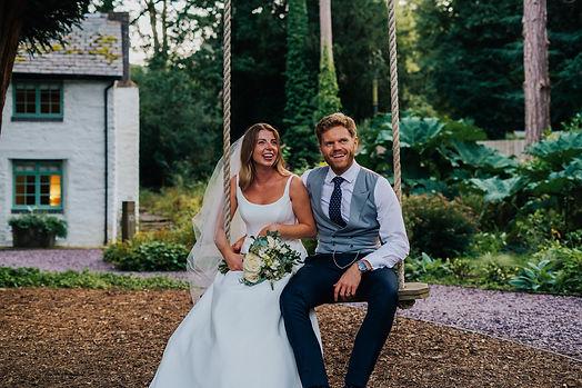 Wedding couple sitting on a swing