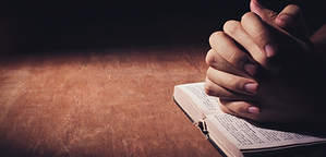praying hands on Bible website.png