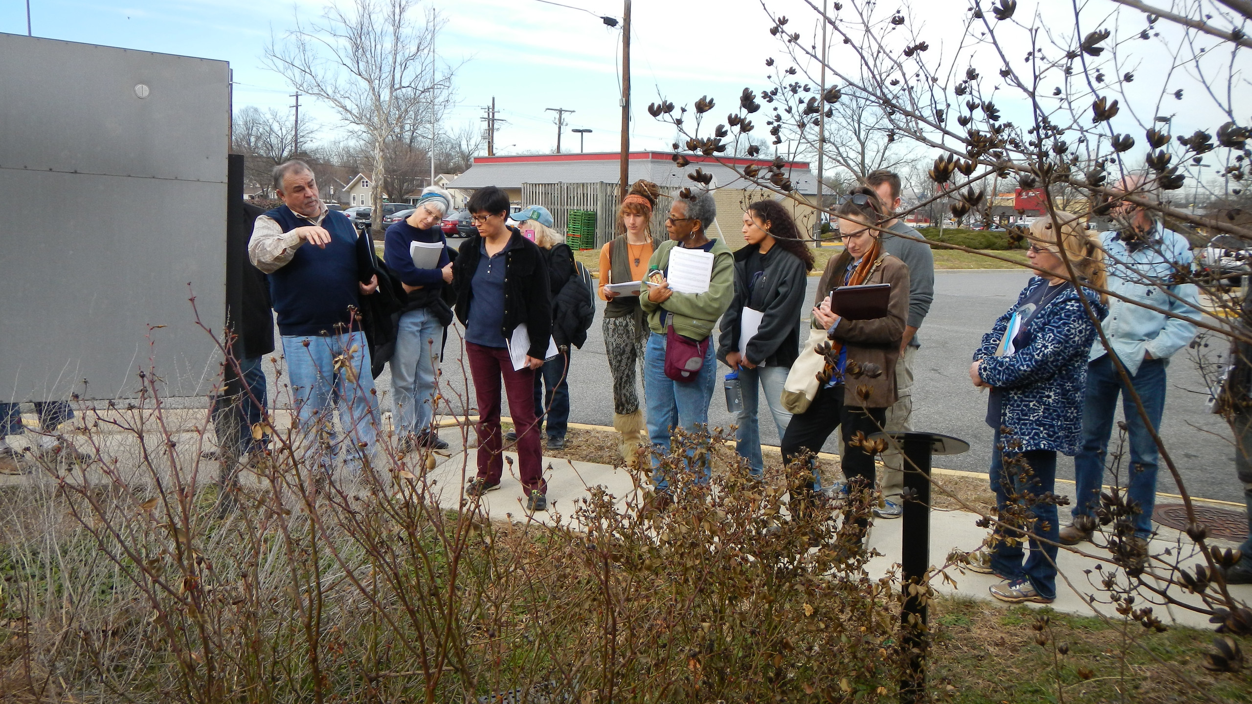 Mike explains function of Colmar Manor Rain Garden - west end of Port Town Shopping Center.