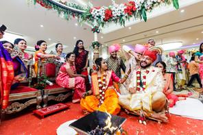 maharashtrian wedding candid photography ear twisting