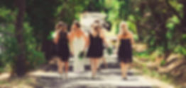 bridesmaids walking down road