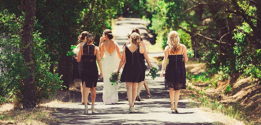 bridesmaids walking down road