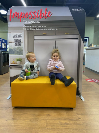 Noah and Lily in Reis Appliance.jpg