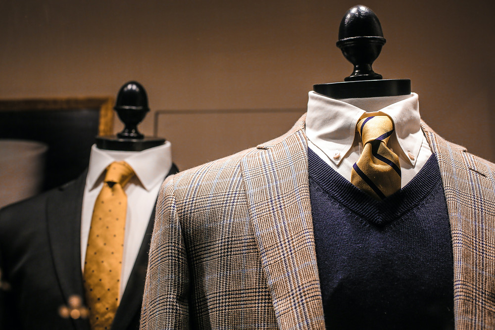 A couple of luxury suits with bold tie combinations