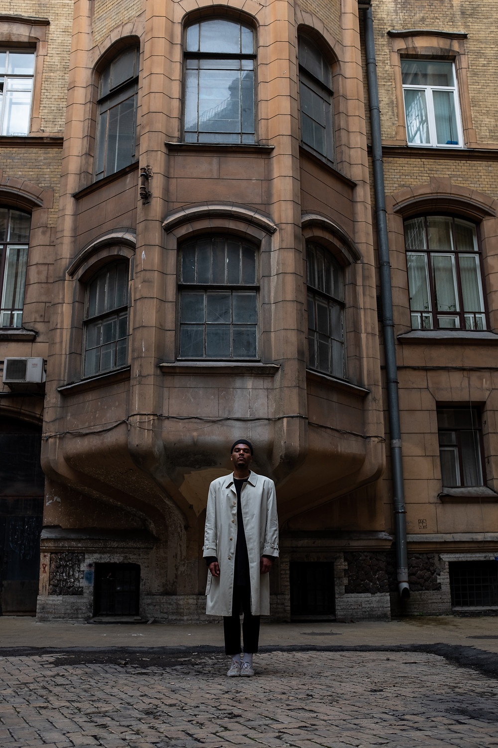 A man in a long white overcoat