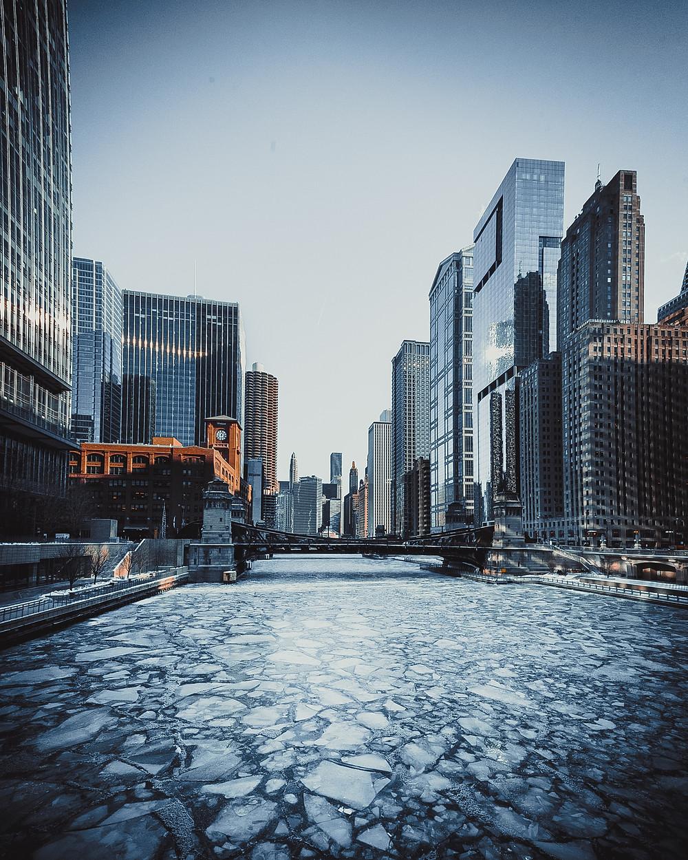 a cityscape with a semi frozen river