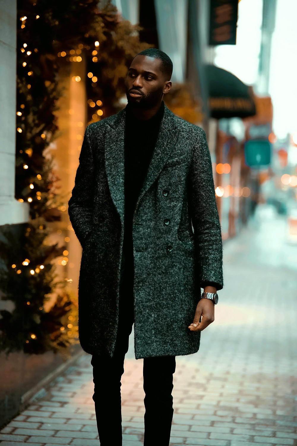 a man in a thick grey overcoat