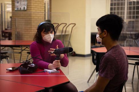 Melissa Rosales interviews a student (Photo by Gabriella Parsons).