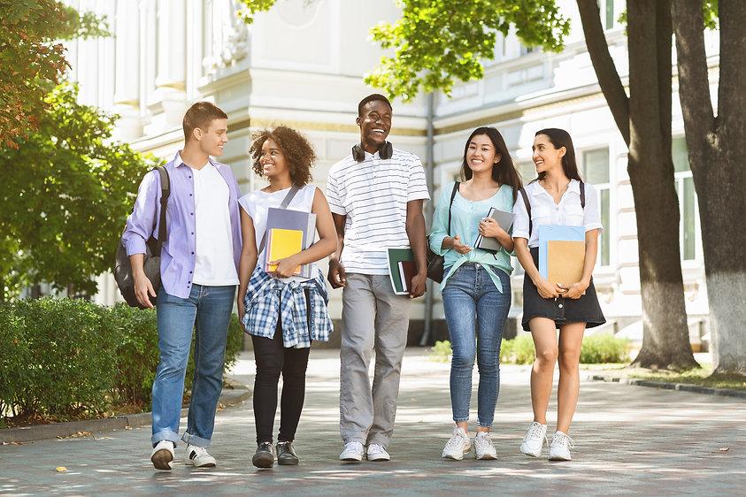 Happy university students walking togeth