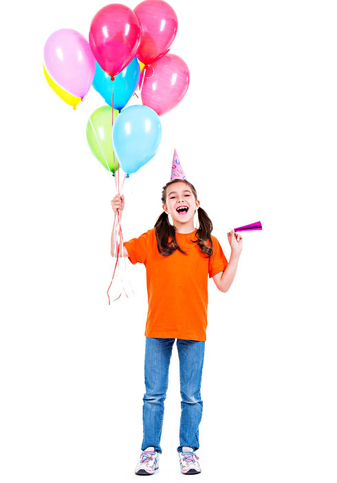 Portrait of happy smiling girl in orange t-shirt holding colorful balloons - isolated on a
