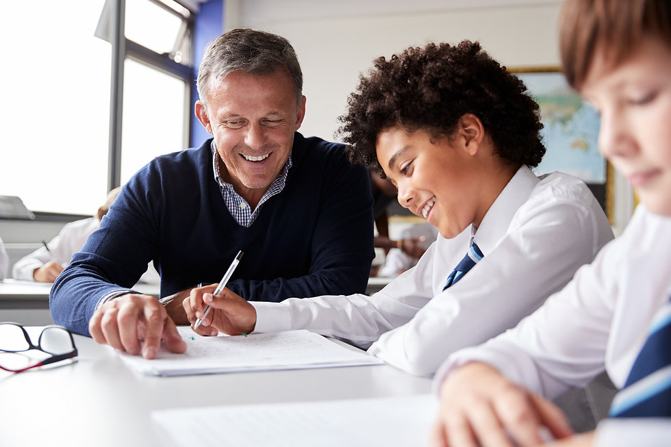 Male teacher, school boy, Royal National Children's SpringBoard Foundation, social mobility, broadening access, life-changing opportunities, pastoral care