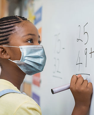 girl in mask, pupil, whiteboard, maths, Royal National Children's SpringBoard Foundation, social mobility, broadening access, schools, disadvantaged