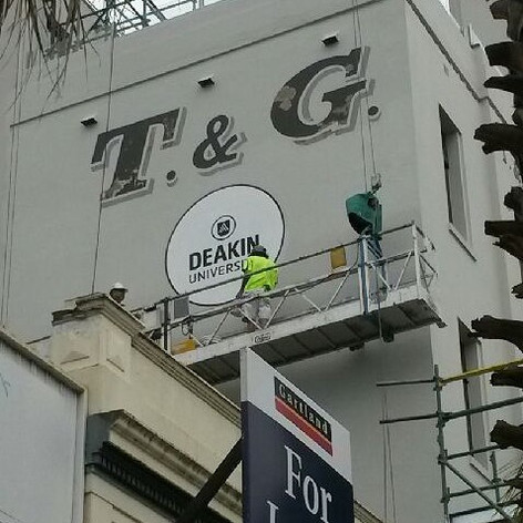 Hand painted Deakin Logo at the T&G Buil