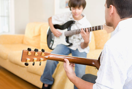 Child taking Guitar Lessons