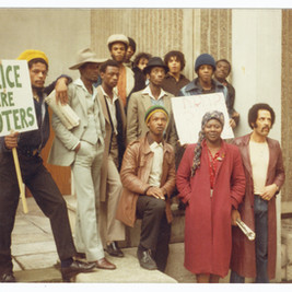 Bristol Archives: Simba Tongogara collection: 43567/Ph/1/1-4  The image illustrates protestors standing outside Bristol Magistrates' Court and relate to freeing those facing charges brought about following the St Pauls disturbance (April 2nd 1980).