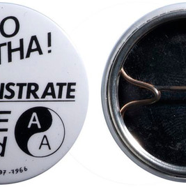 © The Trustees of the British Museum.  A badge created in 1984 for an Anti-Apartheid Movement march in London. The South African Prime Minister, Pieter Willem Botha, was due to have a meeting with the British Prime Minister Margaret Thatcher.